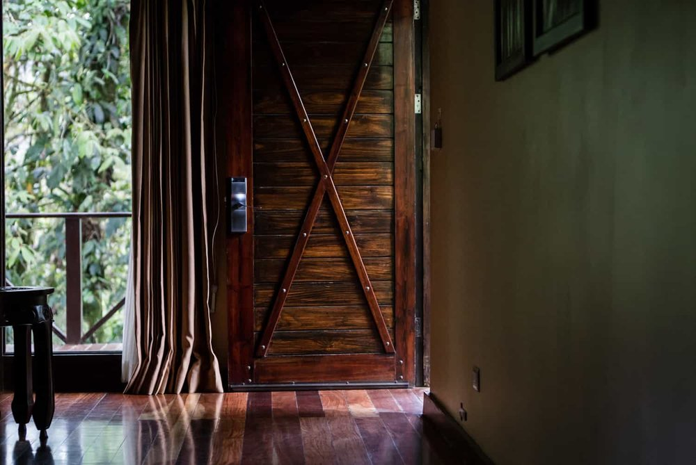 Beautiful wood door in Rio Celeste Hideaway Hotel's honeymoon suite.