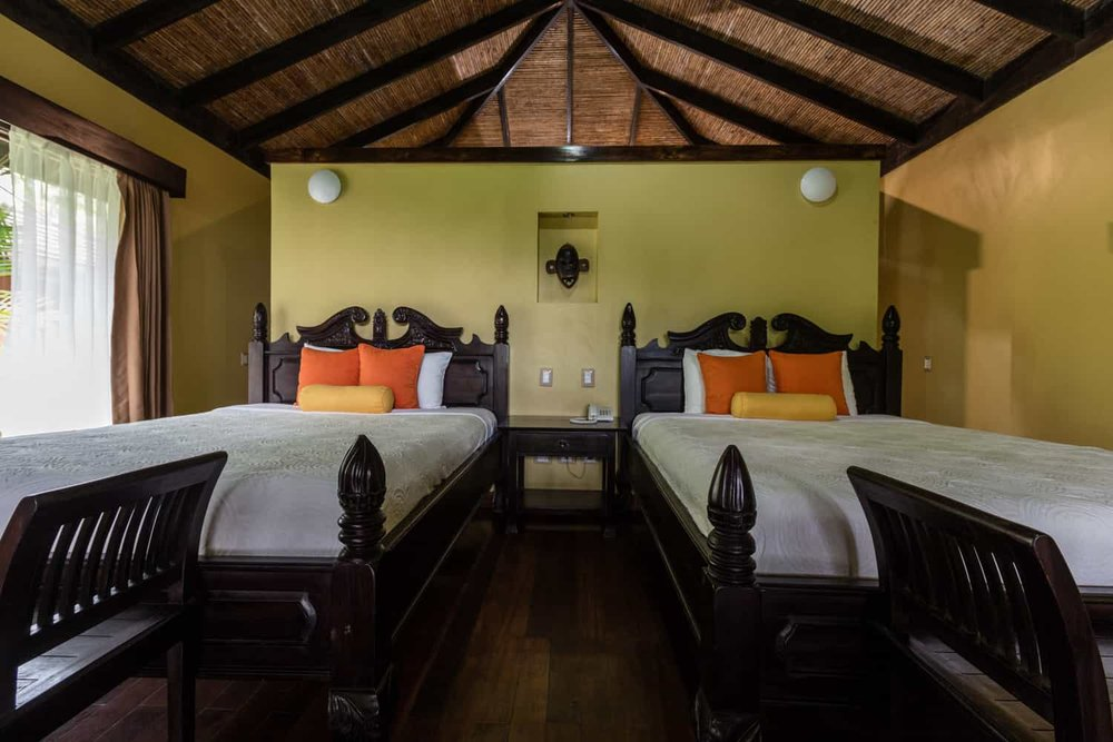 Two queen beds in Rio Celeste Hideaway Hotel's rainforest guest room.