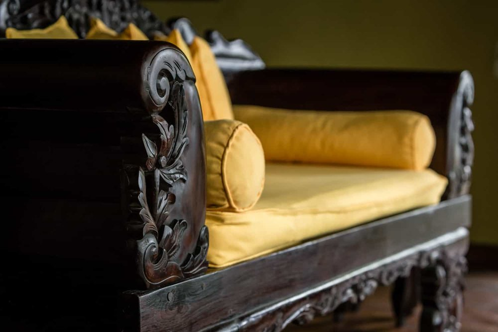 Beautiful wood sofa in boutique accommodations for wedding guests.