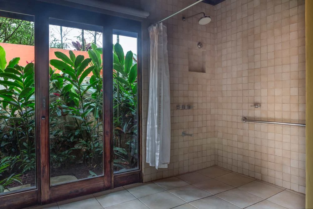 Walk in shower next to french doors with great view.