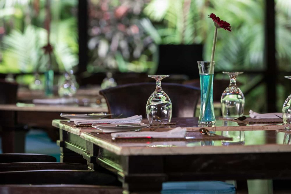 Dining tables with view of botanical garden.