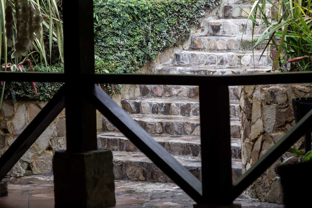 Stone staircase near restaurant leading to poolside wedding day site.