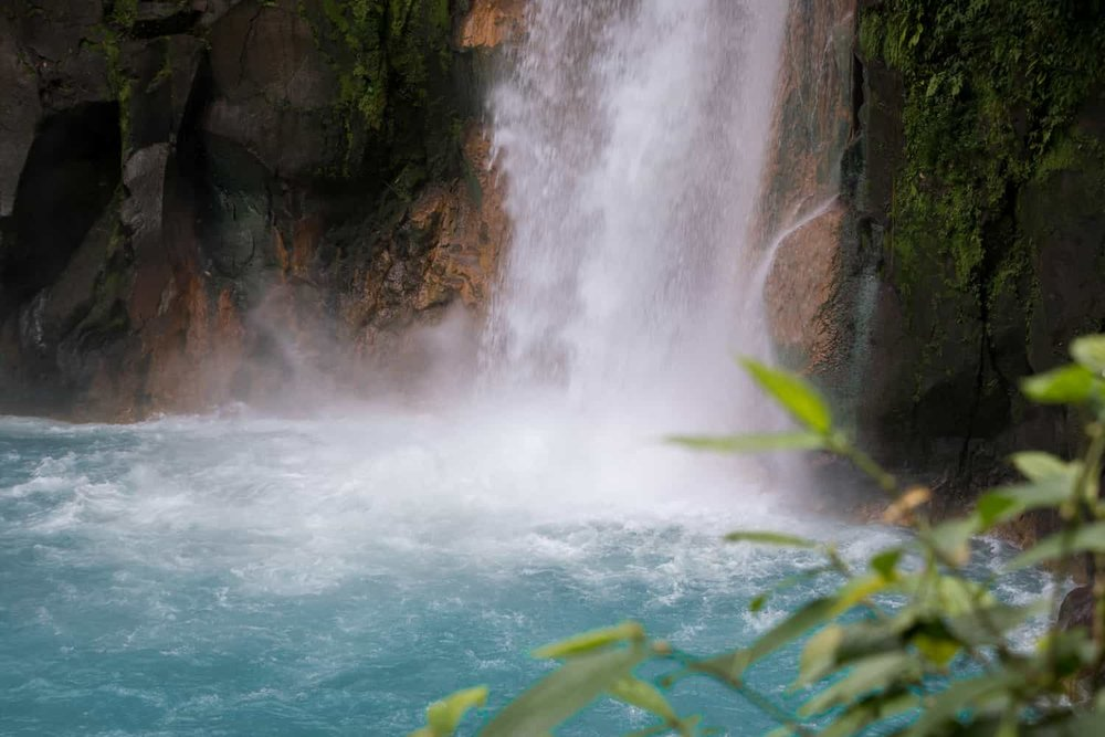 Close-up of base of Rio Celeste Waterfall from wedding ceremony terrace.