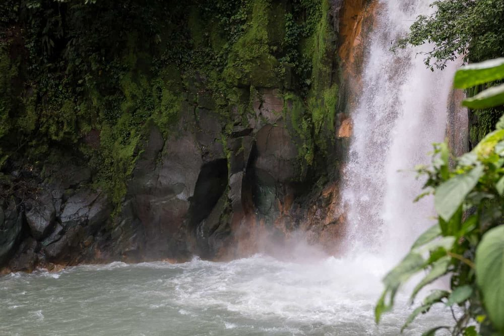 Photo of base of Rio Celeste Waterfall taken from site for weddings.