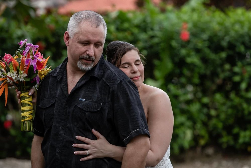 Bride hugs groom during First Looks session in Costa Rica.