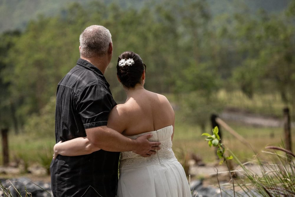 Couple look at Arenal Volcano after getting married in Costa Rica.