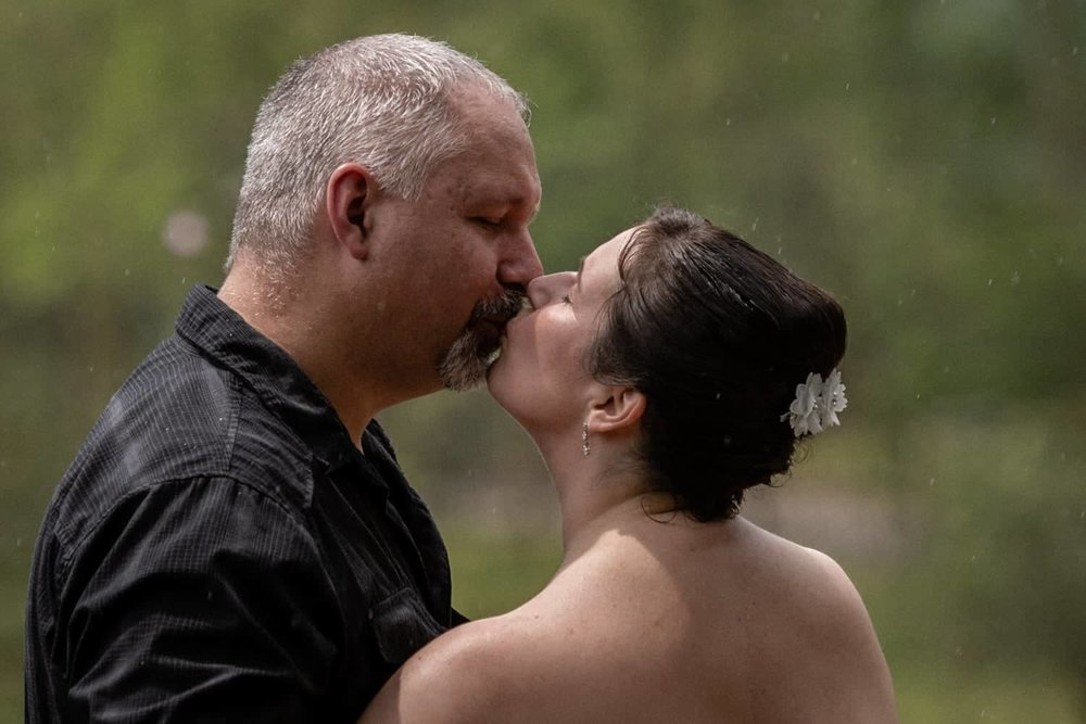 Romantic kiss by couple who tied the knot in Costa Rica.