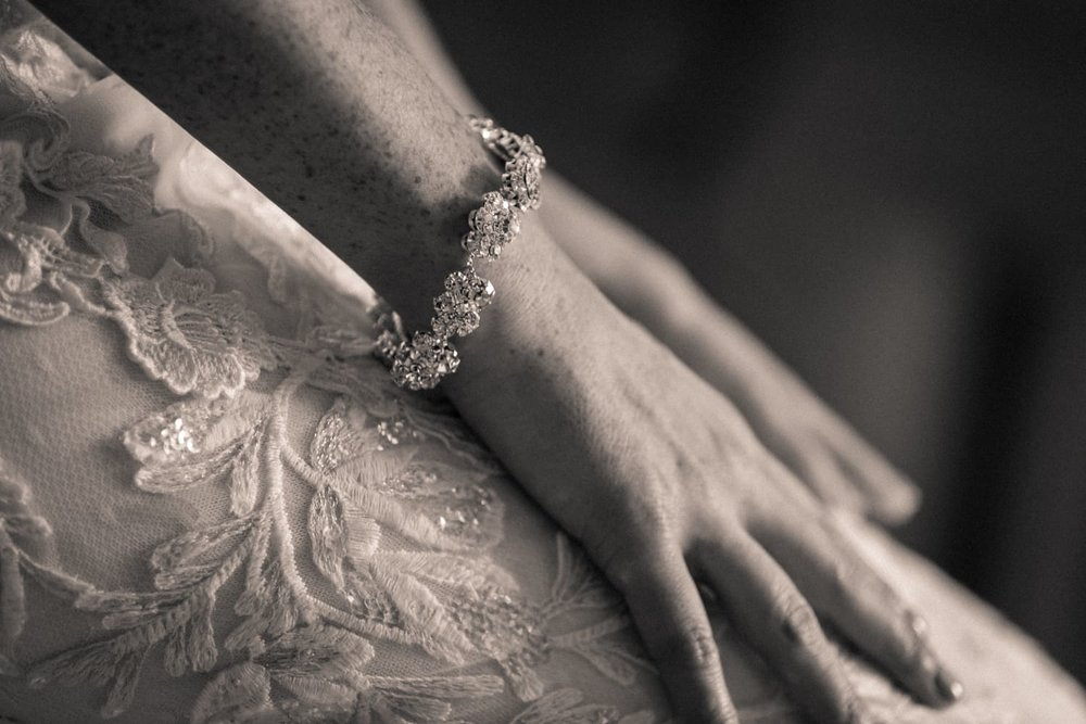 Black & white photo of bride wearing beautiful bracelet.