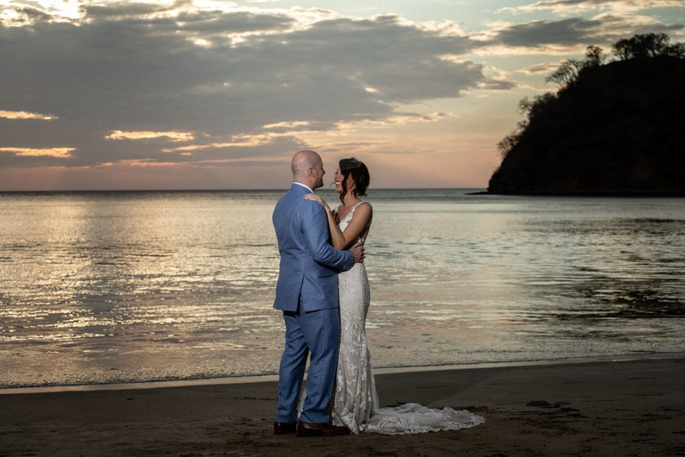 Picture of bride an groom at sunset on beach in Guanacaste.