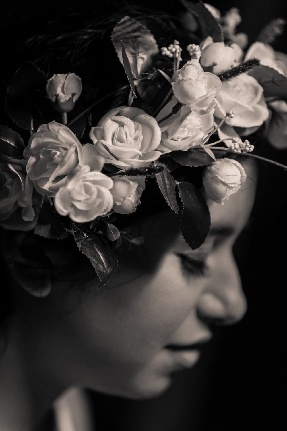 Black and white photo of gorgeous bridal crown with white flowers.