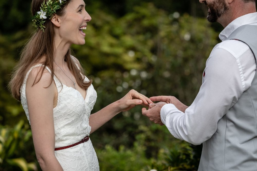 Couple exchanges wedding rings after saying vows in Costa Rica.
