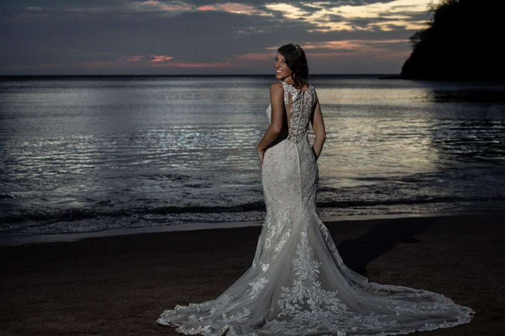 Sunset beach photo of bride wearing beautiful wedding gown at Dreams Las Mareas.