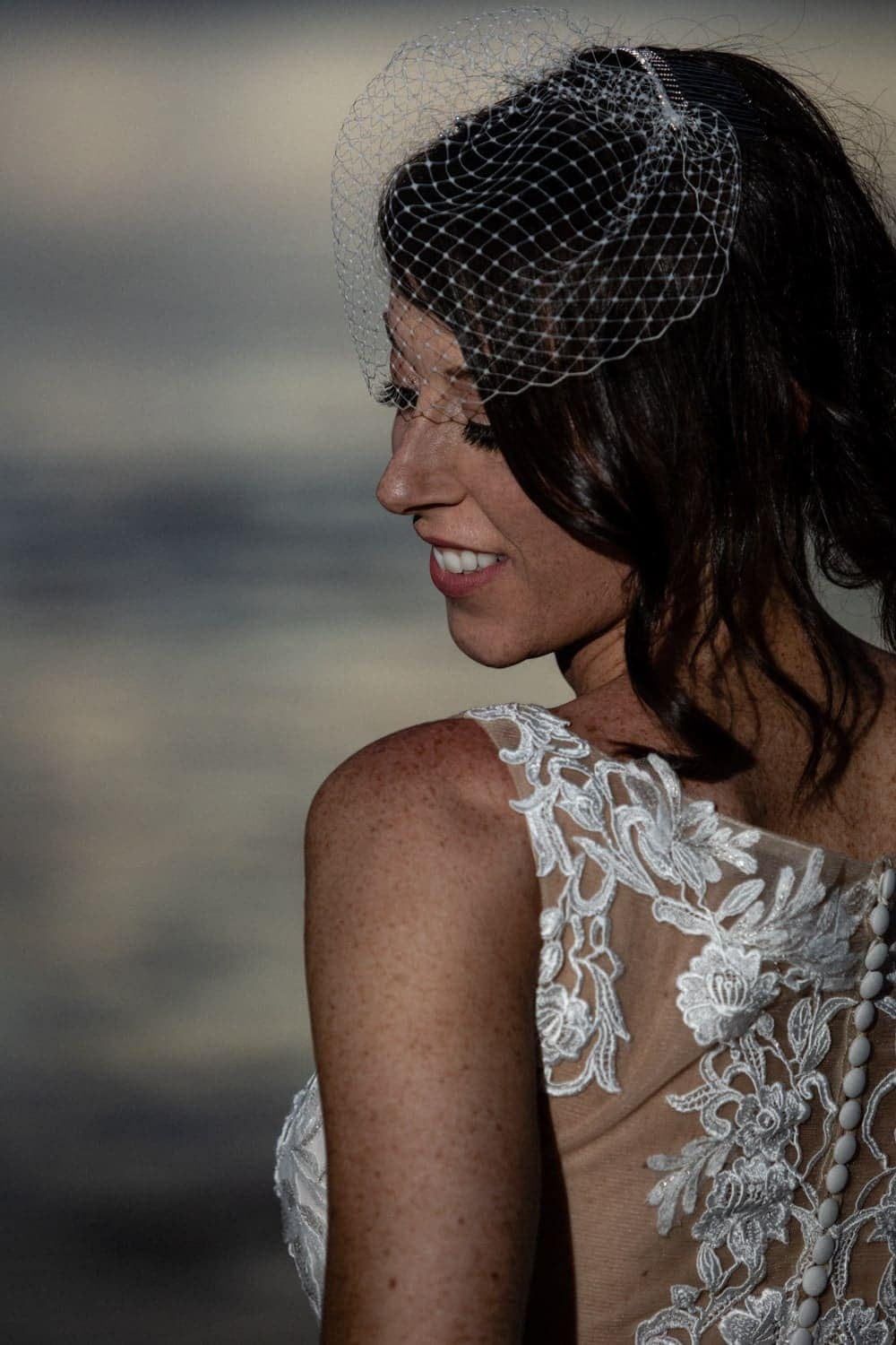 Sunset beach photo of bride in amazing wedding dress in Costa Rica.