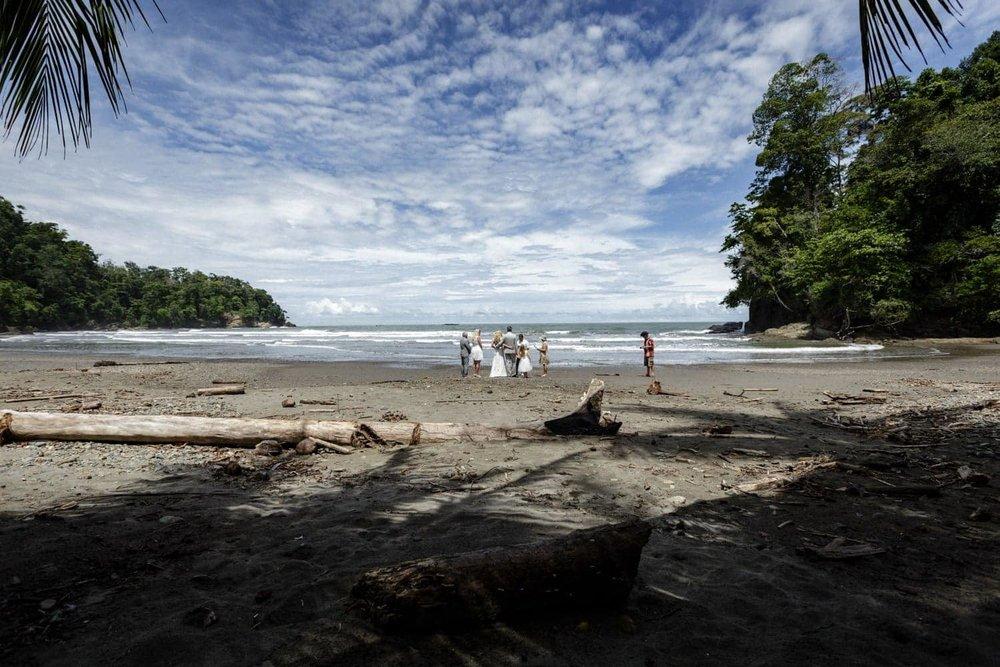 Panoramic photo of beach wedding ceremony in Ojochal, Costa Rica.