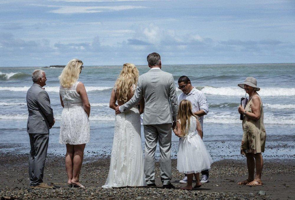 Intimate beach wedding ceremony in Ojochal, Costa Rica.