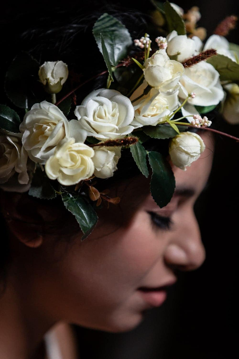 Photo of gorgeous floral bridal crown with ivory flowers.