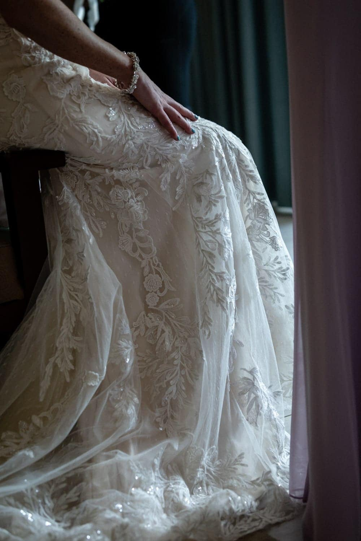 Photo of gorgeous wedding dress during bridal preparation.