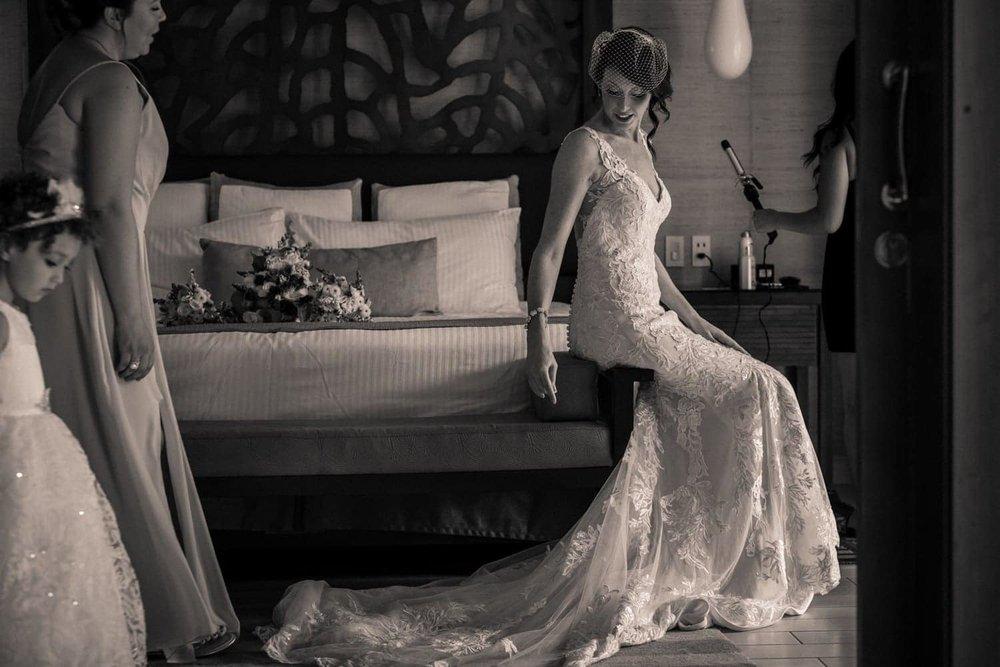 Bridesmaids attend to bride during bridal preparation in Dreams Las Mareas suite.