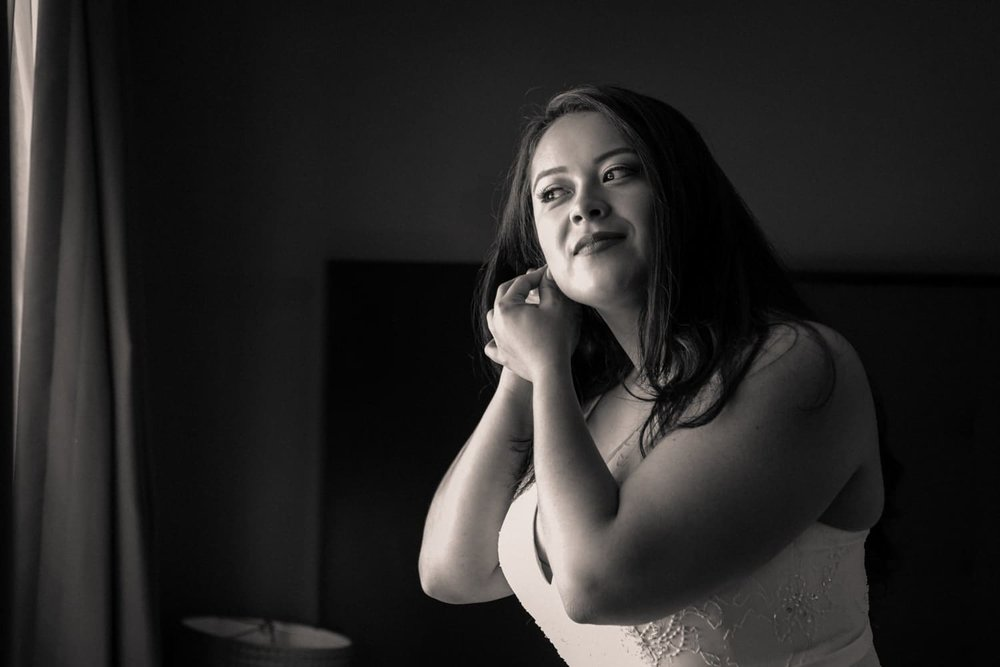Black and white photo of bride preparing for wedding in Costa Rica.