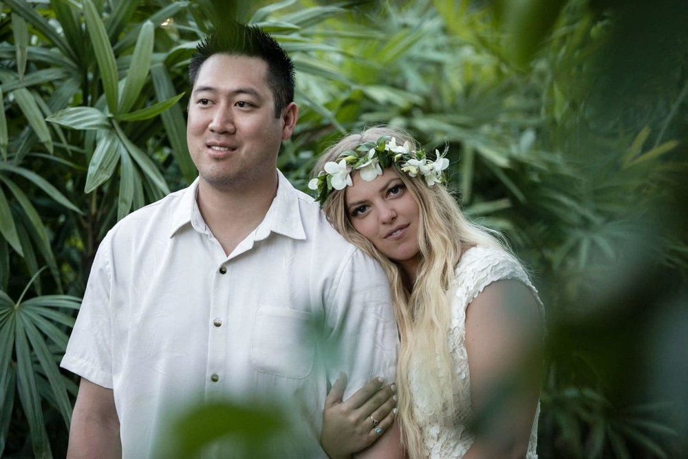 Photo of just married couple in tropical garden in Costa Rica.