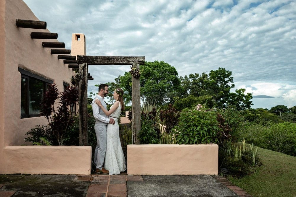 Just married couple poses for photo at amazing rainforest ranch in Costa Rica.