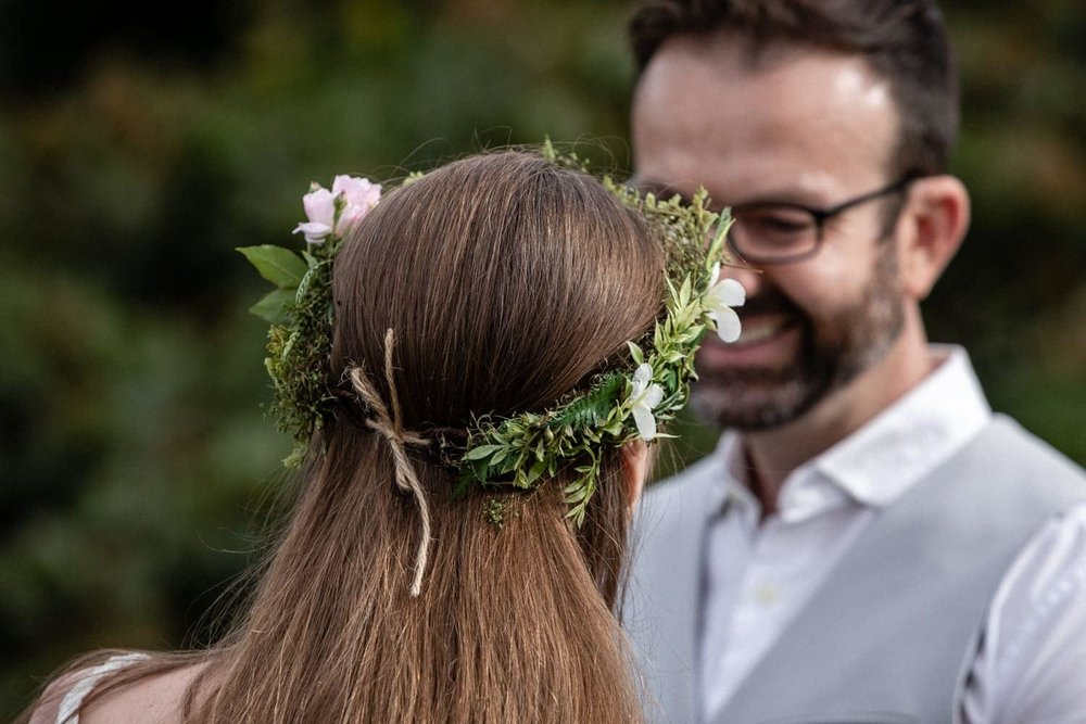 Floral wedding crown with green leaves and flowers from tropical garden.