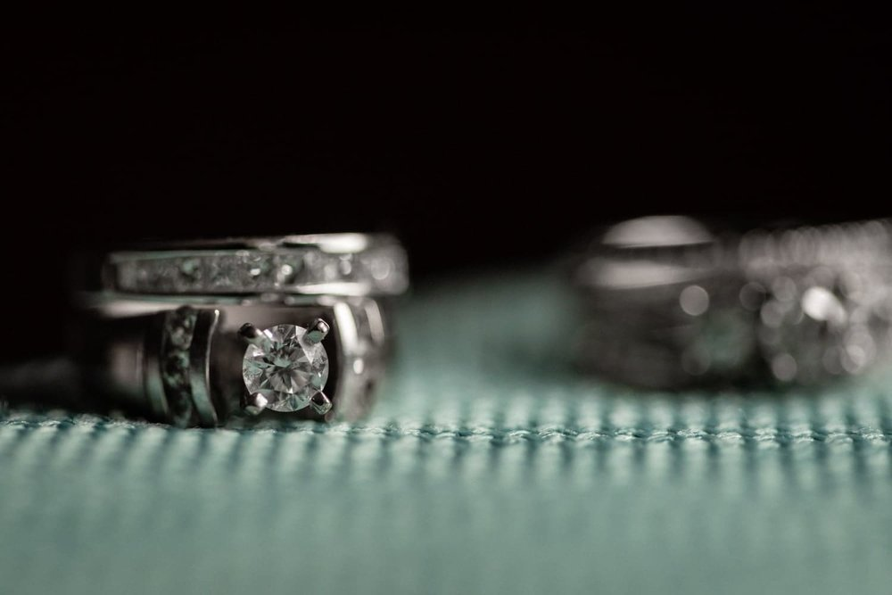 Wedding bands on turquoise fabric in honeymoon suite at Secrets Papagayo.