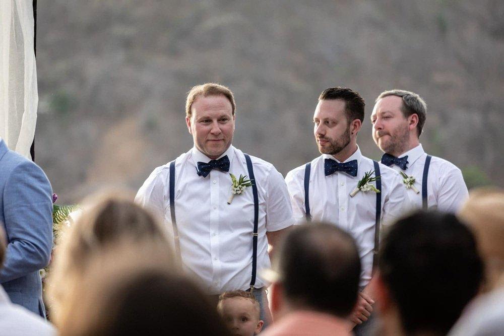 Groomsmen standing on beach during Costa Rica wedding.