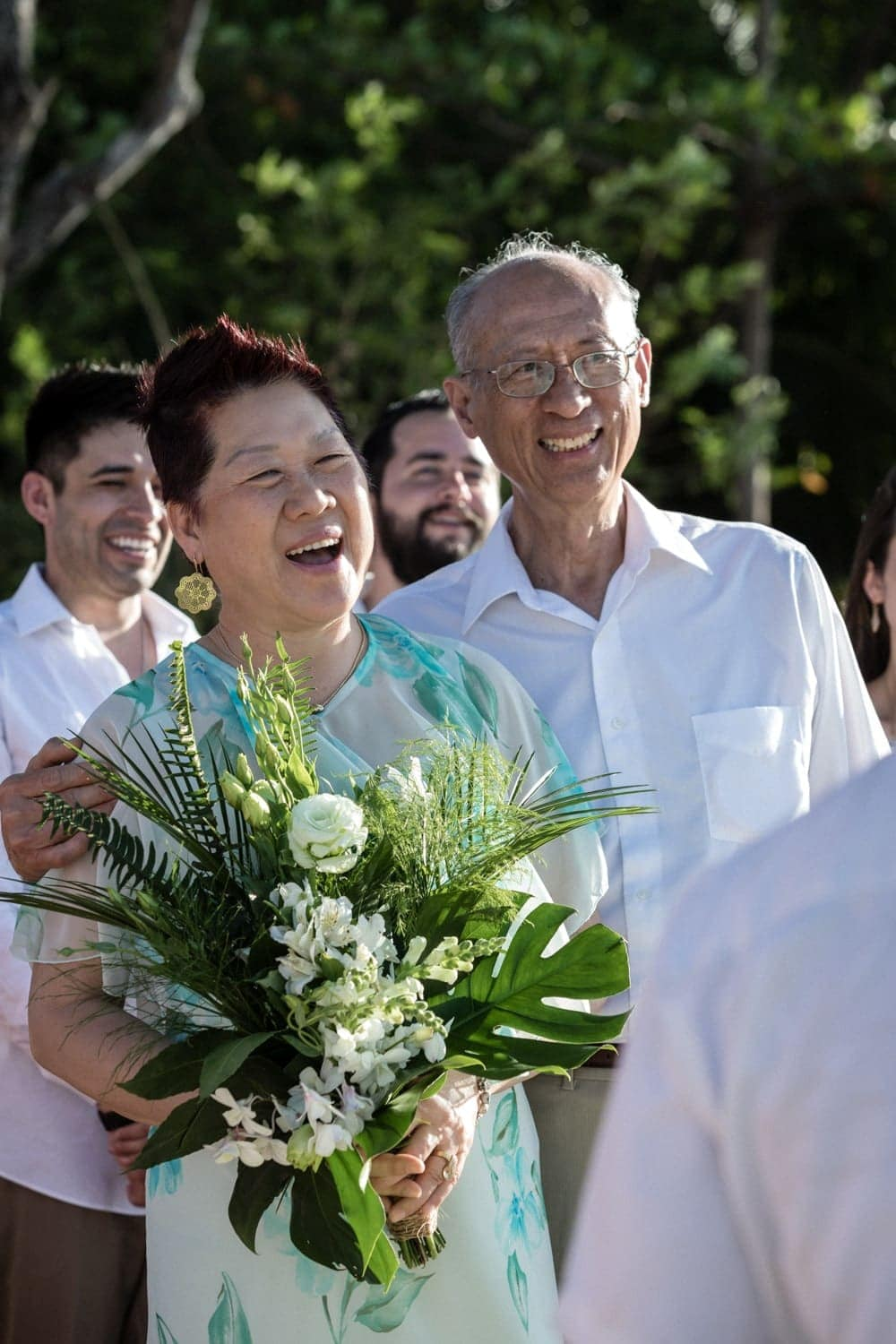 Parents of groom smile as son ties the knot in Costa Rica.