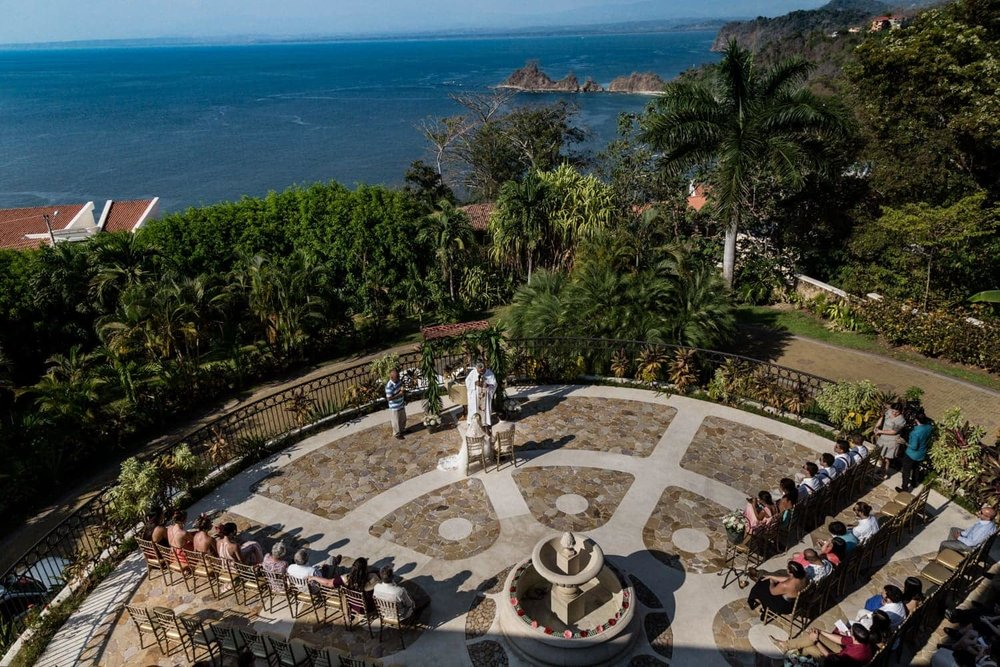 Wedding ceremony on terrace at Villa Avalon with view of Pacific Ocean.