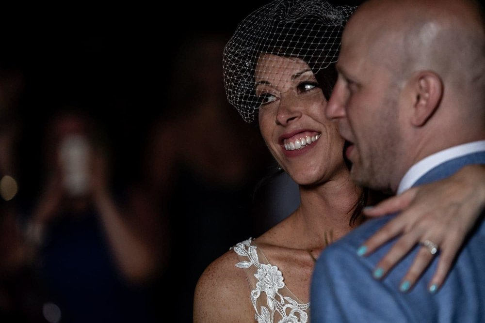 Couple share their first dance as married couple during wedding reception.