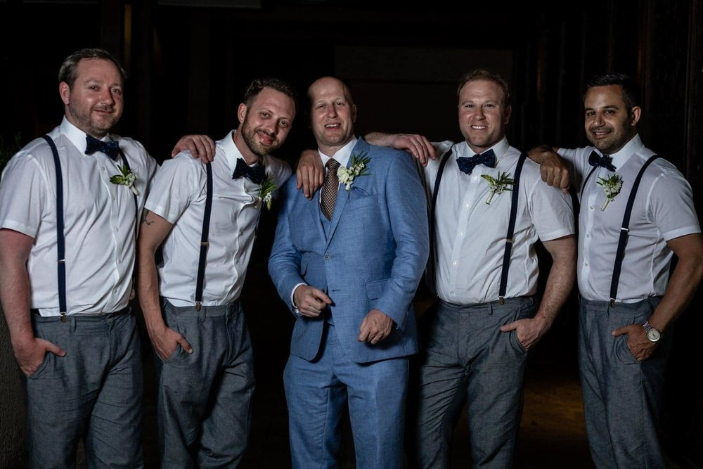 Photo of groom and groomsmen during wedding reception at Dreams Las Mareas.