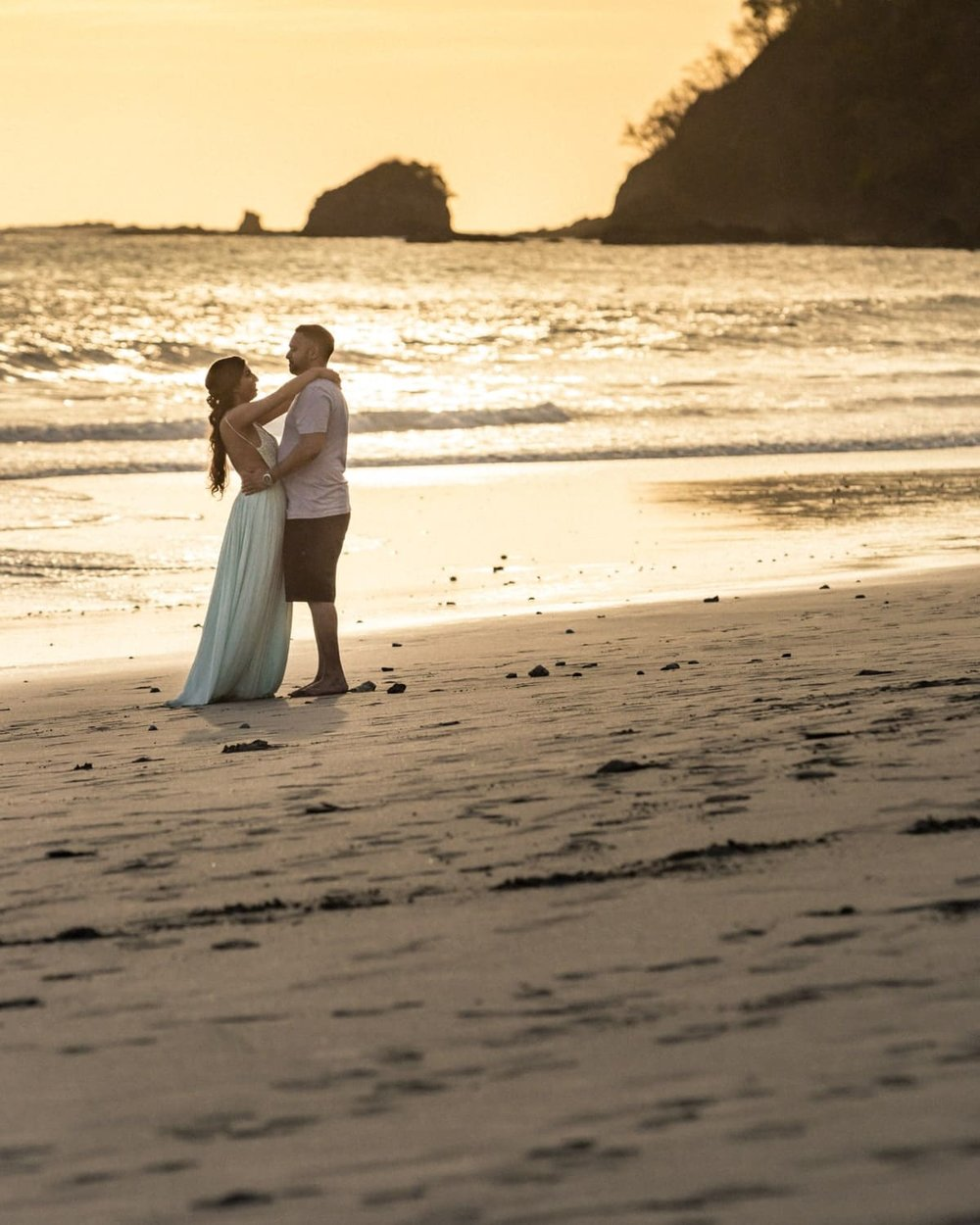 Romantic sunset beach photo of couple during Manuel Antonio engagement session.