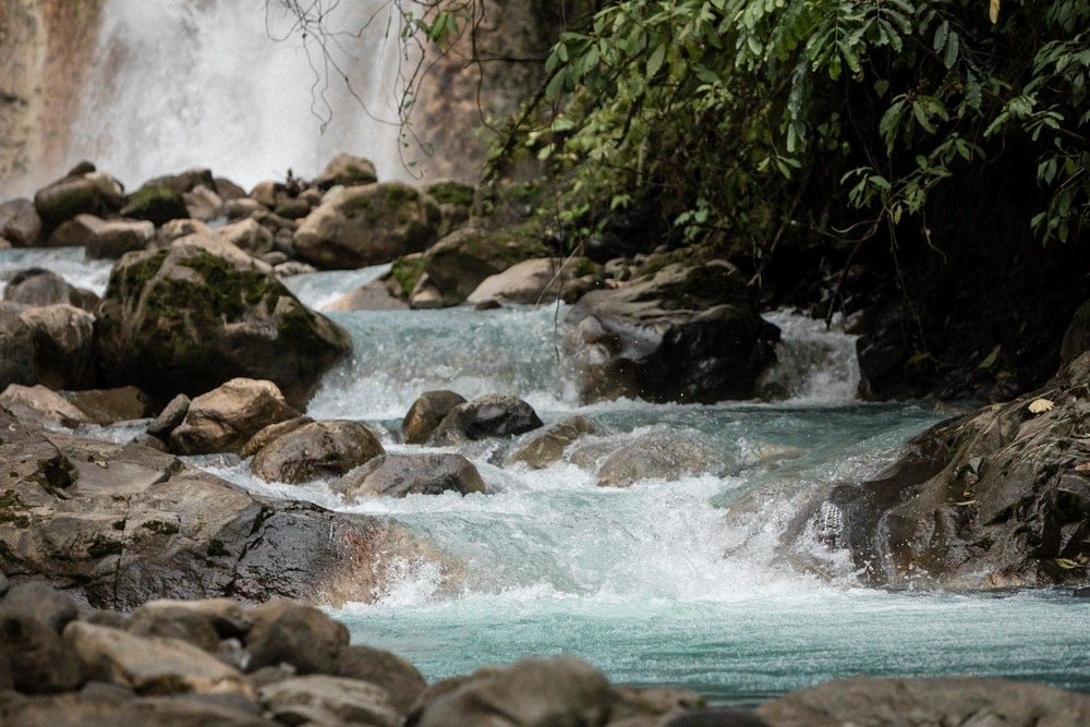 Water flowing from one of the Las Gemelas Waterfalls into a river.