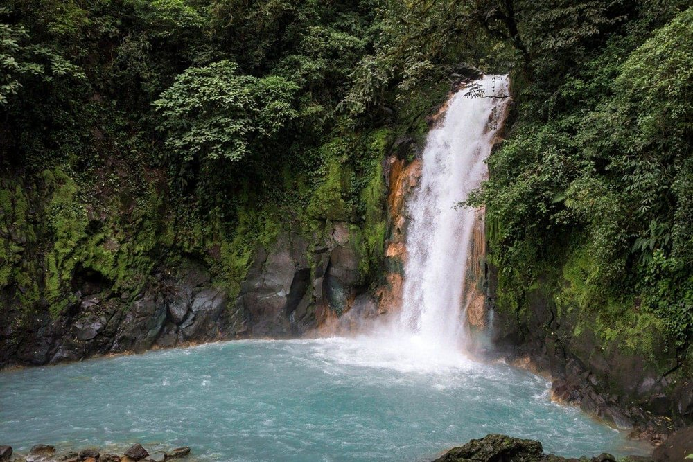 Rio Celeste Waterfall in Tenorio Volcano National Park is a romantic place to get engaged.