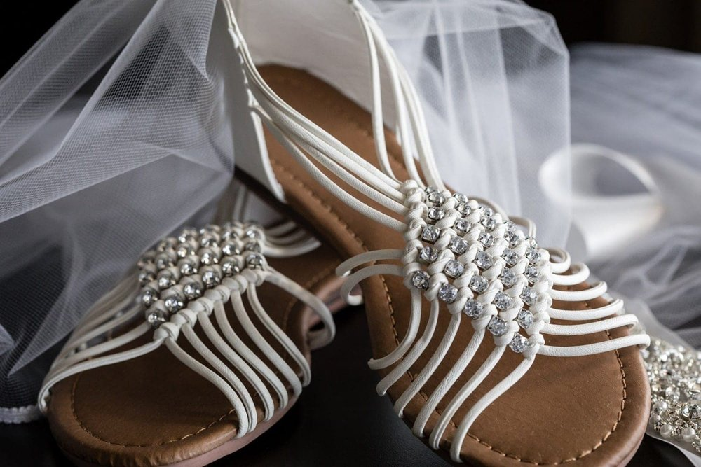 Bride's casual sandals for her beach wedding ceremony in Costa Rica.