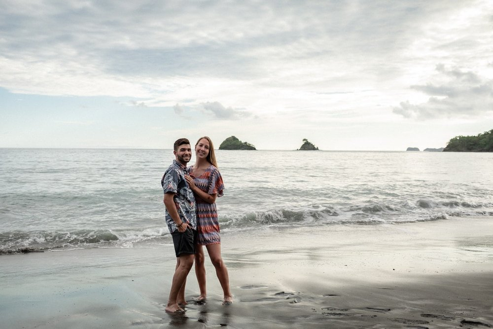 Photo of just engaged couple on beach in Guanacaste at sunset.