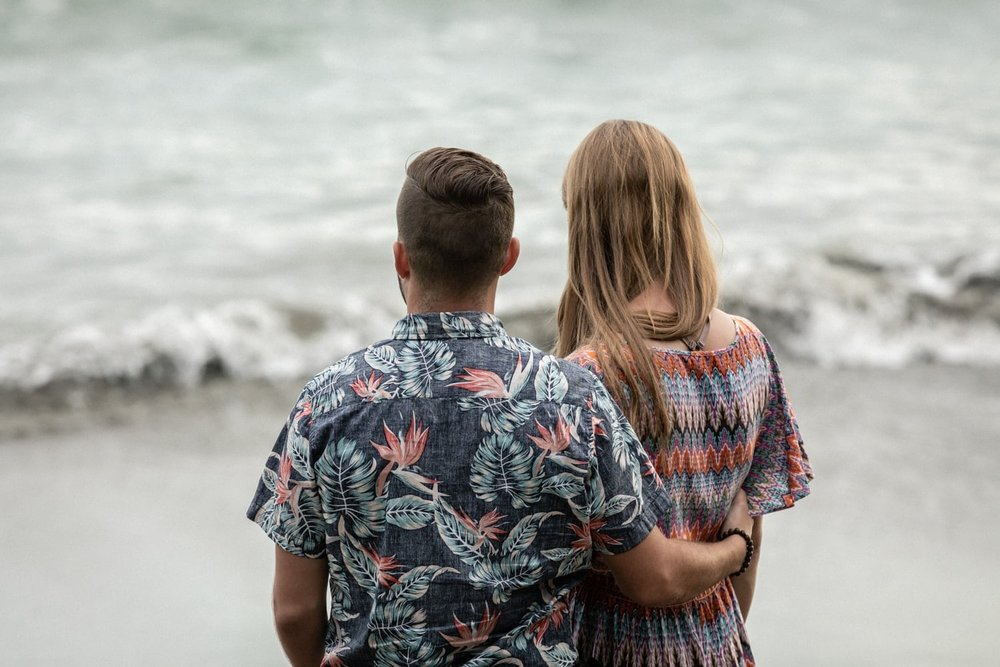 Engagement session photo of couple on beach in Costa Rica.