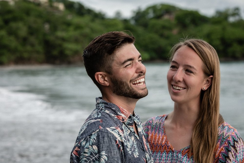 Engagement picture of couple smiling after getting engaged.