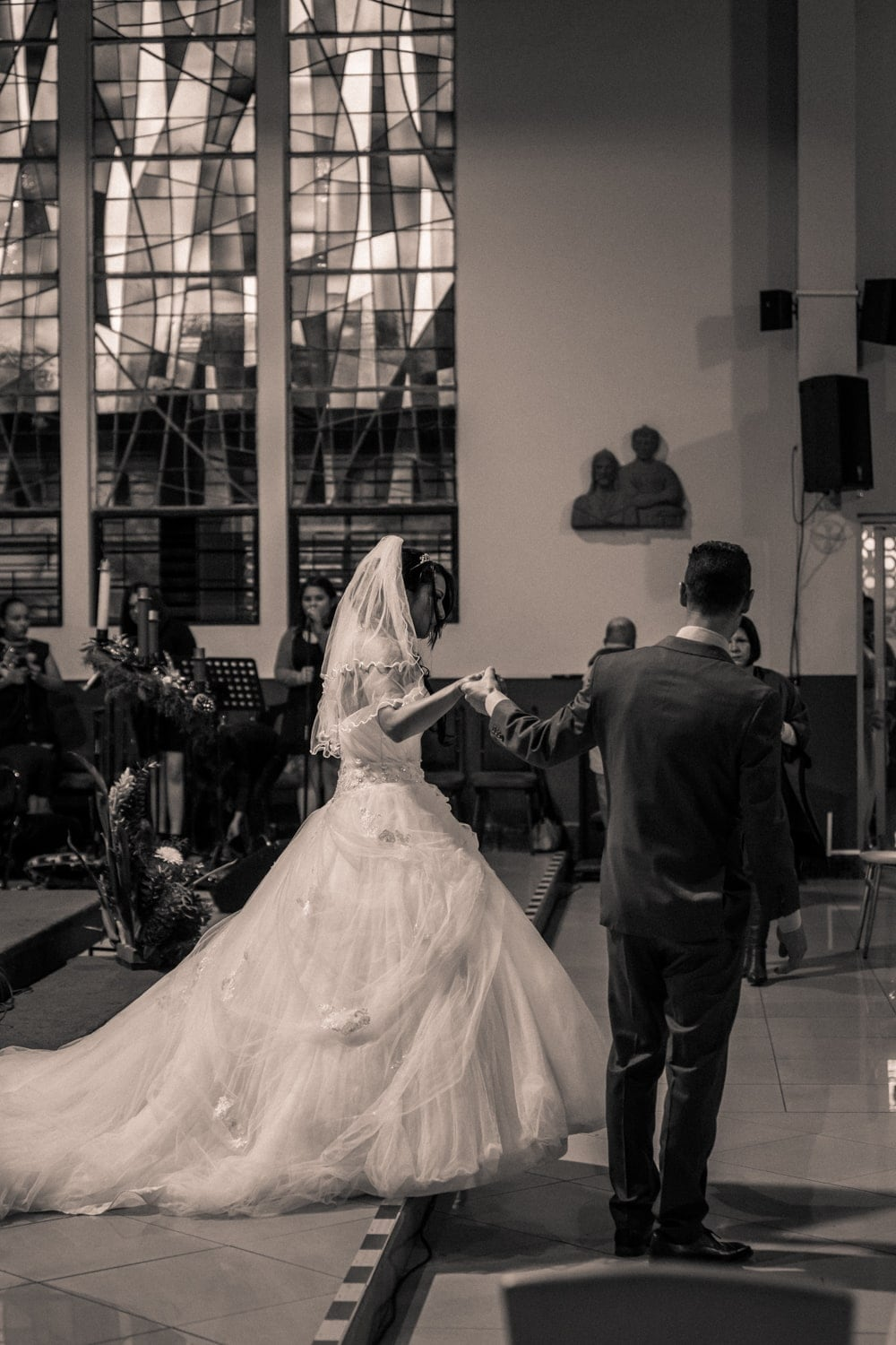 Groom escorts bride out of church after getting married.