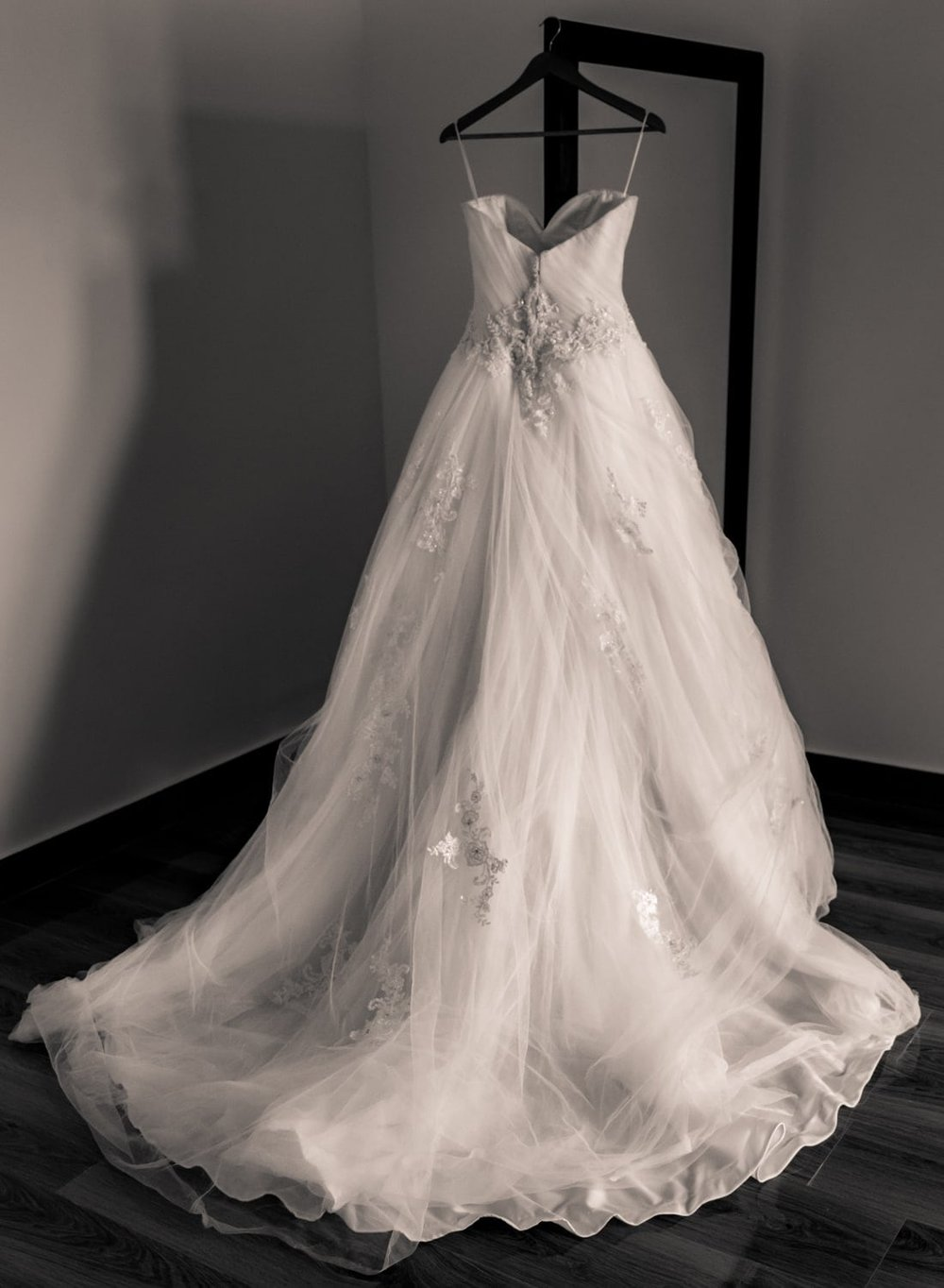 Black and white photo of gorgeous wedding dress.