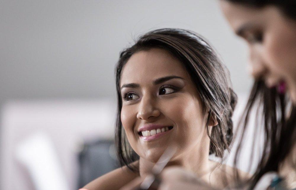 Bride having wedding day makeup applied.