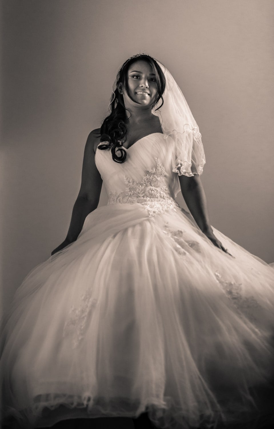 Photo of bride wearing wedding dress just before leaving for church.