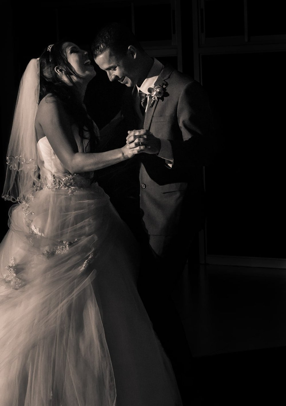 Just married couple enjoy their first dance.