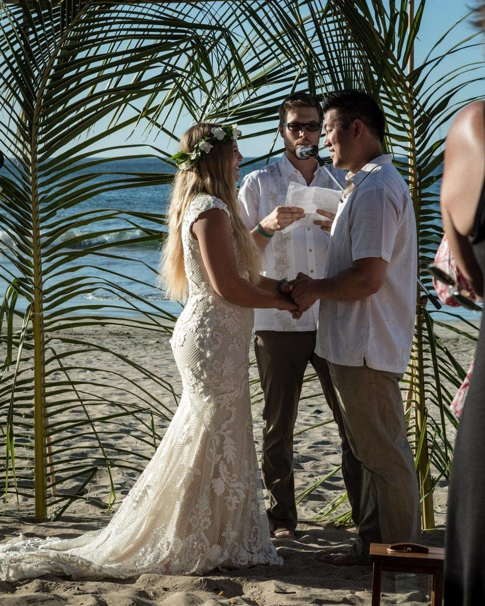Couple getting married at altar on beach in Tamarindo, Costa Rica.