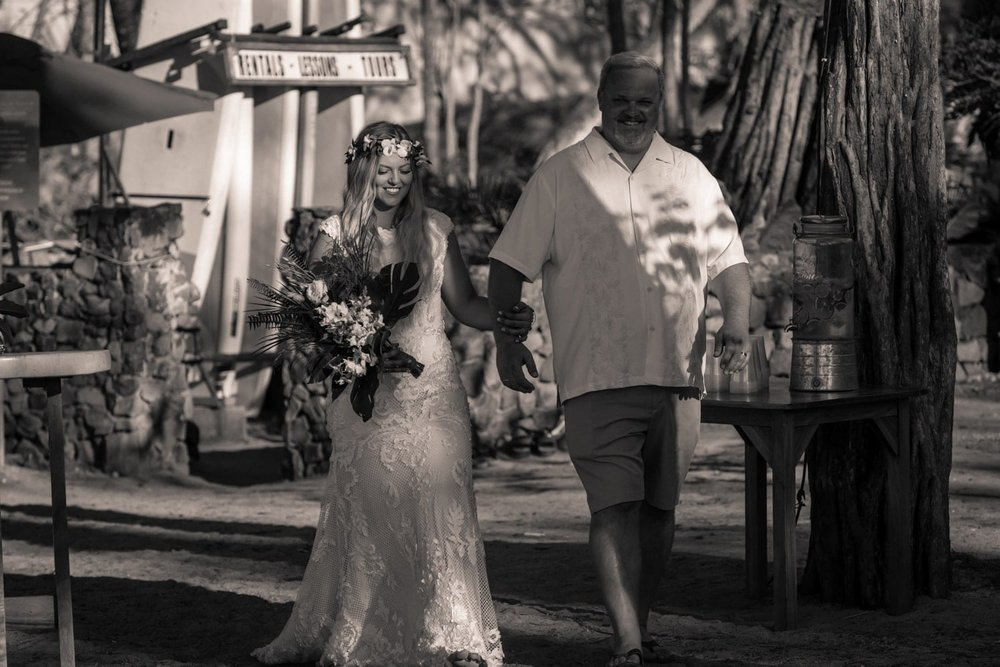 Father walks daughter down aisle at Langosta Beach Club in Tamarindo.