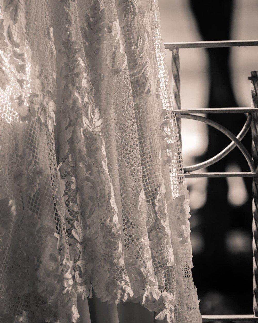 Black and white photo of wedding dress on balcony at Tamarindo Diria Resort.