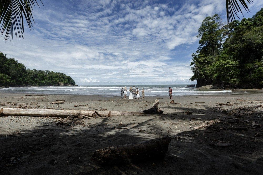 Wide angle photo of beach wedding ceremony in Costa Rica.
