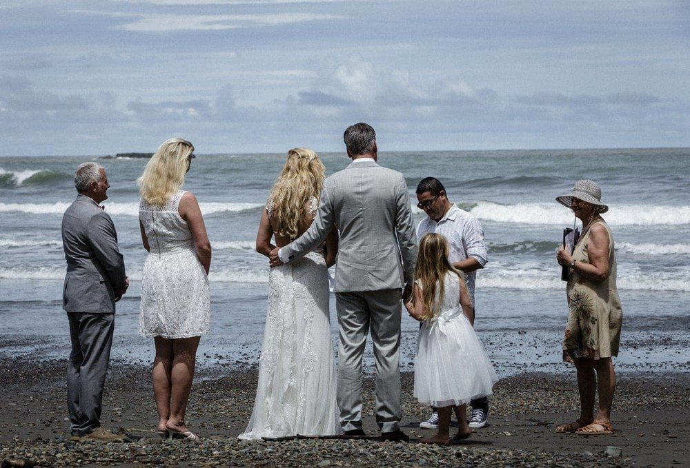 Couple tying the knot on Playa Ventanas Beach in Costa Rica.