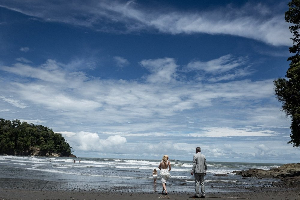Picturesque image of bride and groom on beach after wedding ceremony.